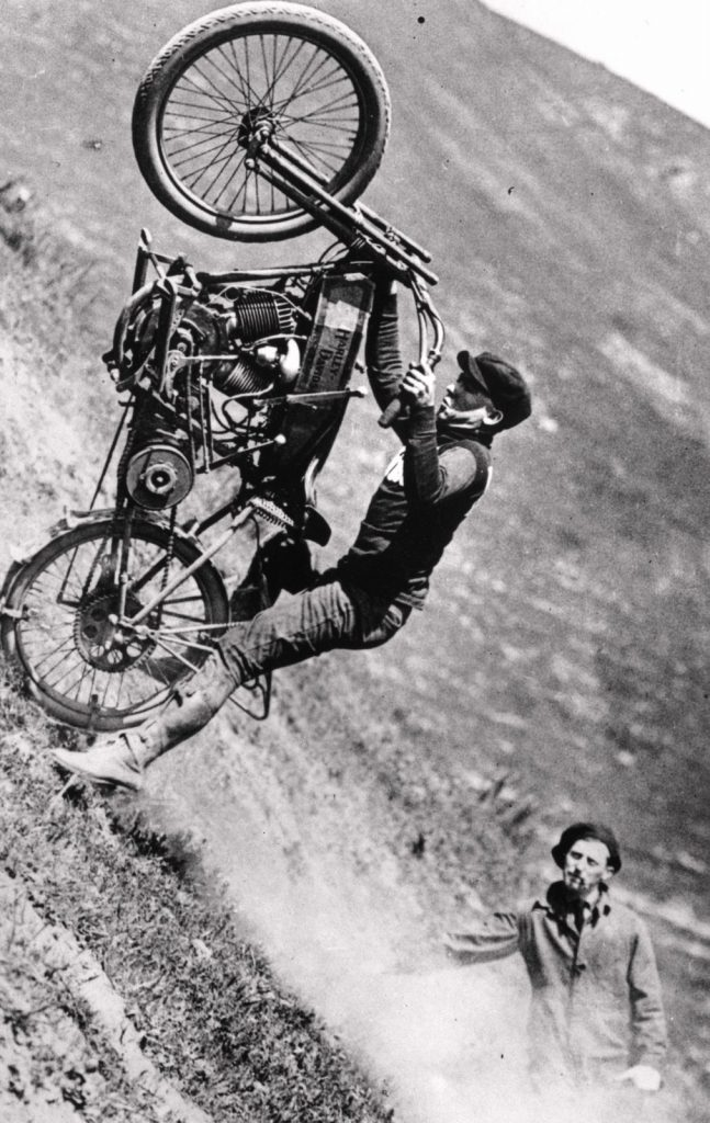 A man puts an early Harley Davidson motorcycle through its paces on a steep gradient. (Photo by General Photographic Agency/Getty Images)